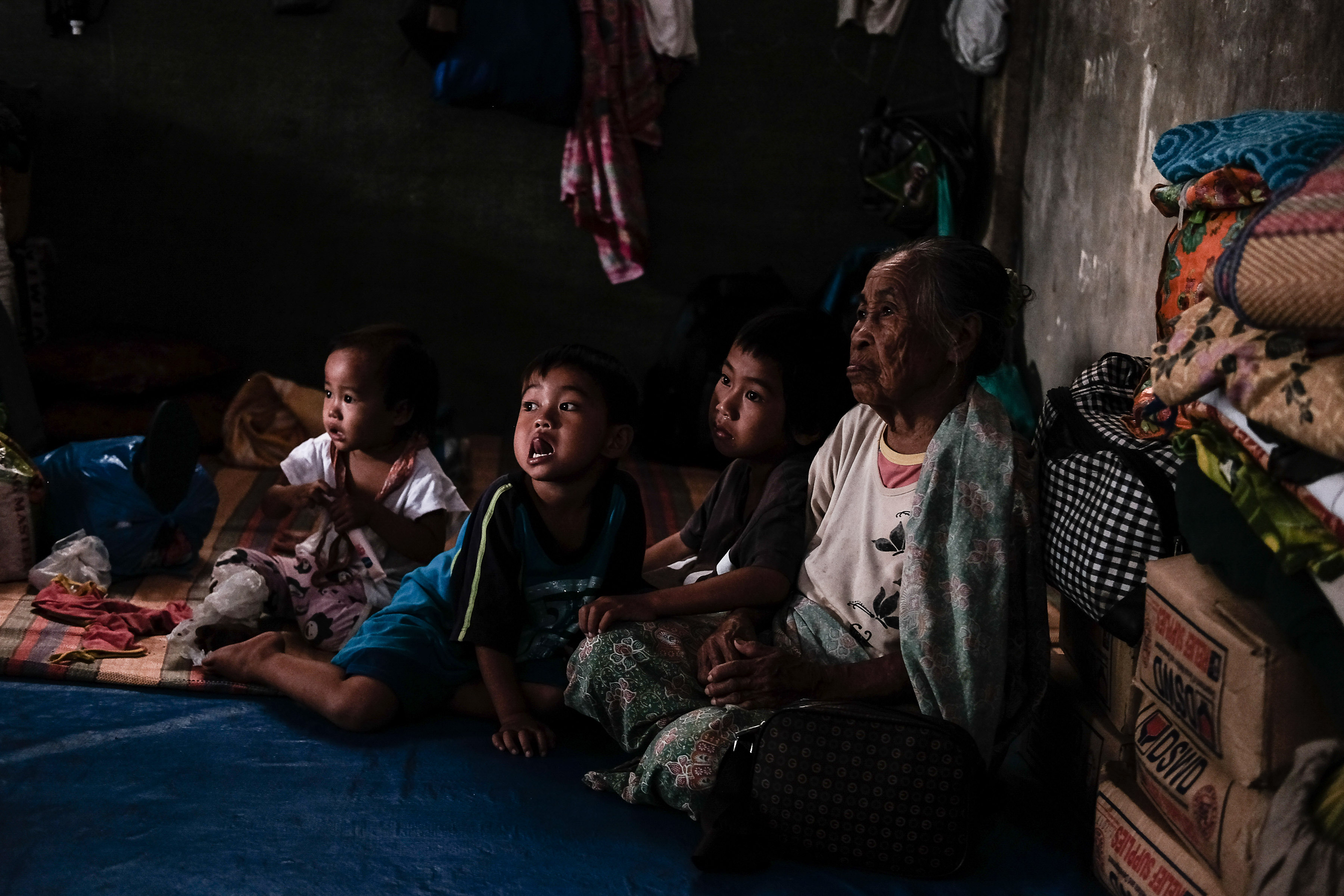 RECOVERY. An elderly Maranao woman is flanked by her grandchildren in Al-Qayriya Madrasa, an evacuation center in Balo-i, Lanao del Norte. Photo by Bobby Lagsa/Rappler