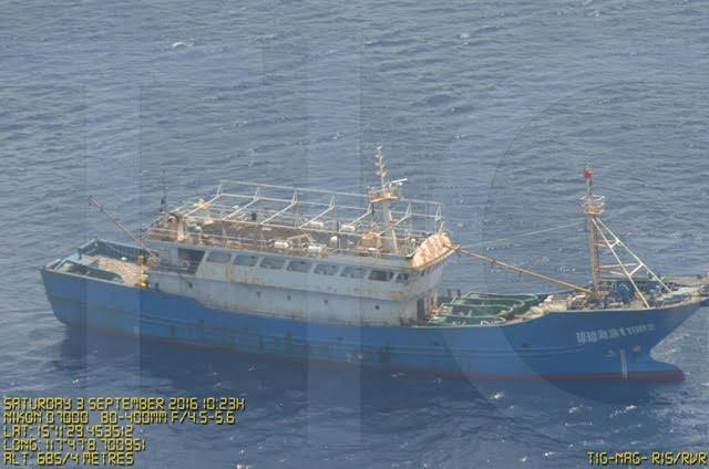 CONTESTED WATERS. A Chinese vessel is shown near the Scarborough Shoal in this surveillance photo by the Philippine Department of National Defense. Photo posted by Agriculture Secretary Manny Piñol on Facebook