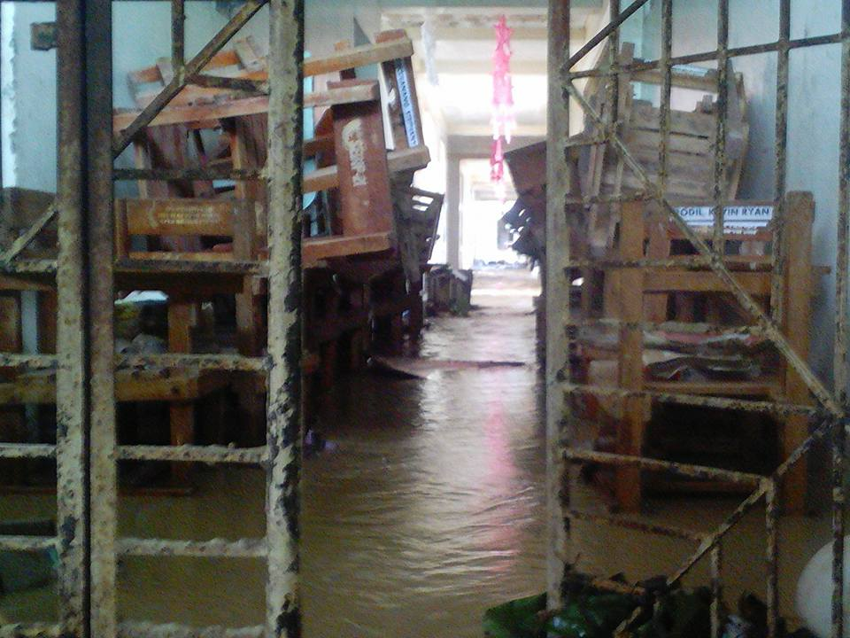 INSIDE THE SCHOOL. Chairs are stacked together in the flood-hit building of the Tucdao National High School. Photo by Rafael Medalla