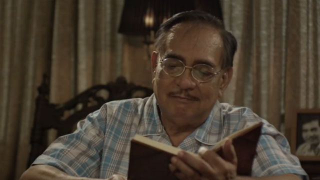 LOOK BACK. Justo (Tommy Abuel goes through some of his notebooks in 'Dagsin.' All screenshots from YouTube/Atom & Anne Mediaworks