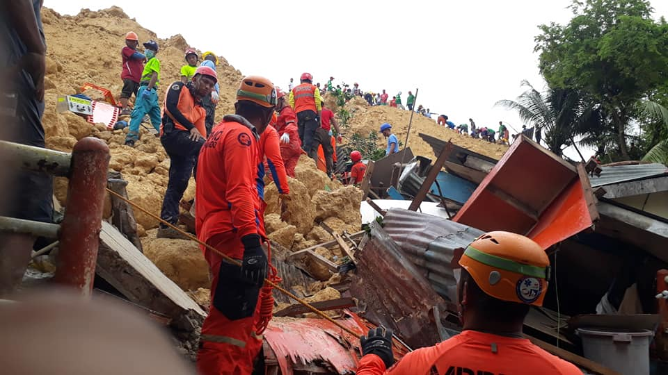 RESCUE CONTINUES. The landslide in Naga City, Cebu last Thursday is affecting hundreds of families currently living in evacuation centers. File photo by Jadee Borinaga