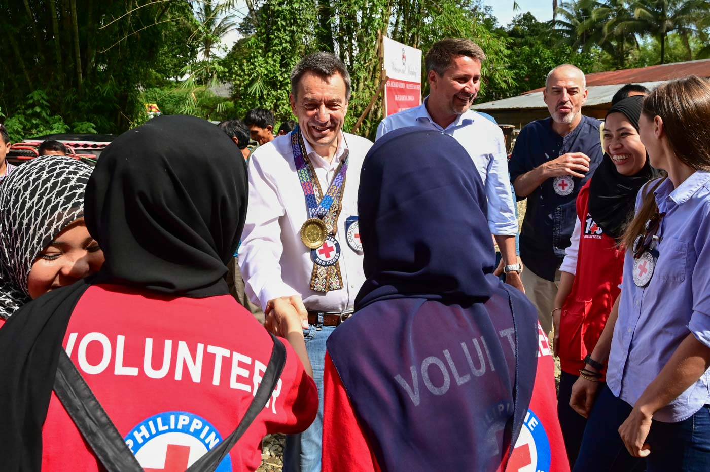 WELCOME. ICRC President Peter Maurer with ICRC Regional Director Boris Michel, ICRC Head of Delegation Martin Thalmann, and ICRC Sub-delegation Head Roberto Petronio are welcomed by PRC staff and volunteers at the Bualan Spring Project in Lanao Del Sur on June 3, 2019. All photos by Alecs Ongcal/ICRC