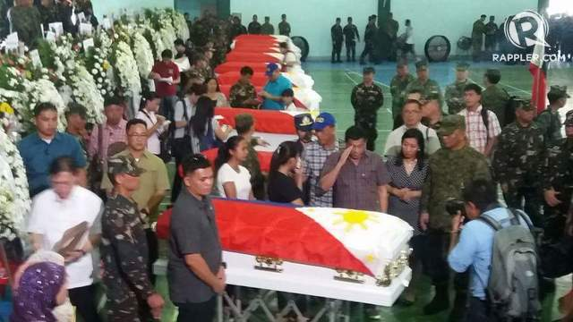 SALUTE. President Duterte salutes the body of a fallen soldier who died during an encounter with the Abu Sayyaf in Zamboanga City. Photo by Richard Falcatan/Rappler