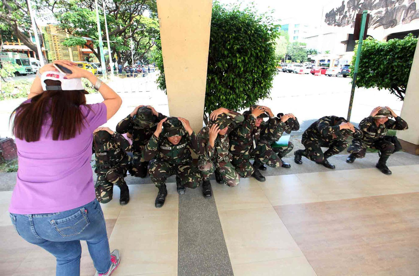COVER. Soldiers cover their heads during the Nationwide Earthquake Drill, at the Quezon City Hall grounds in Quezon City, March 31, 2017. The drill aims to increase effort in public awareness of the ever-looming possibility of strong earthquake. Photo by Nelson Vera/Rappler