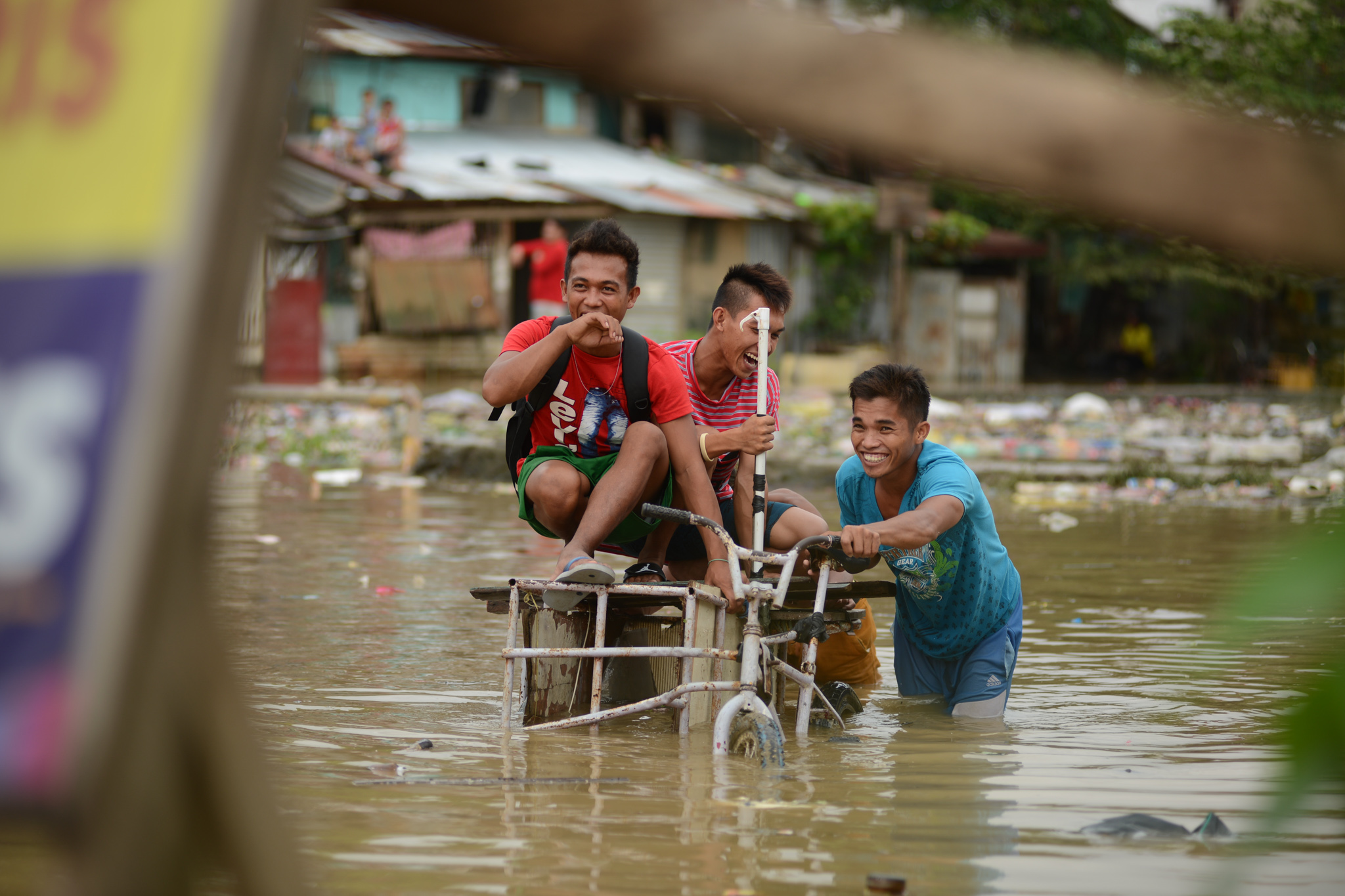 INUNDATED. Men navigate through a flooded area in Marikina City, August 14, 2016. Photo by Martin San Diego/Rappler