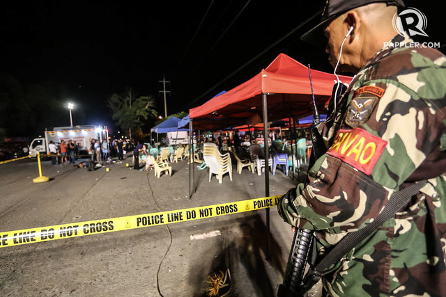 HEIGHTENED ALERT. A member of Task Force Davao secures the blast site.