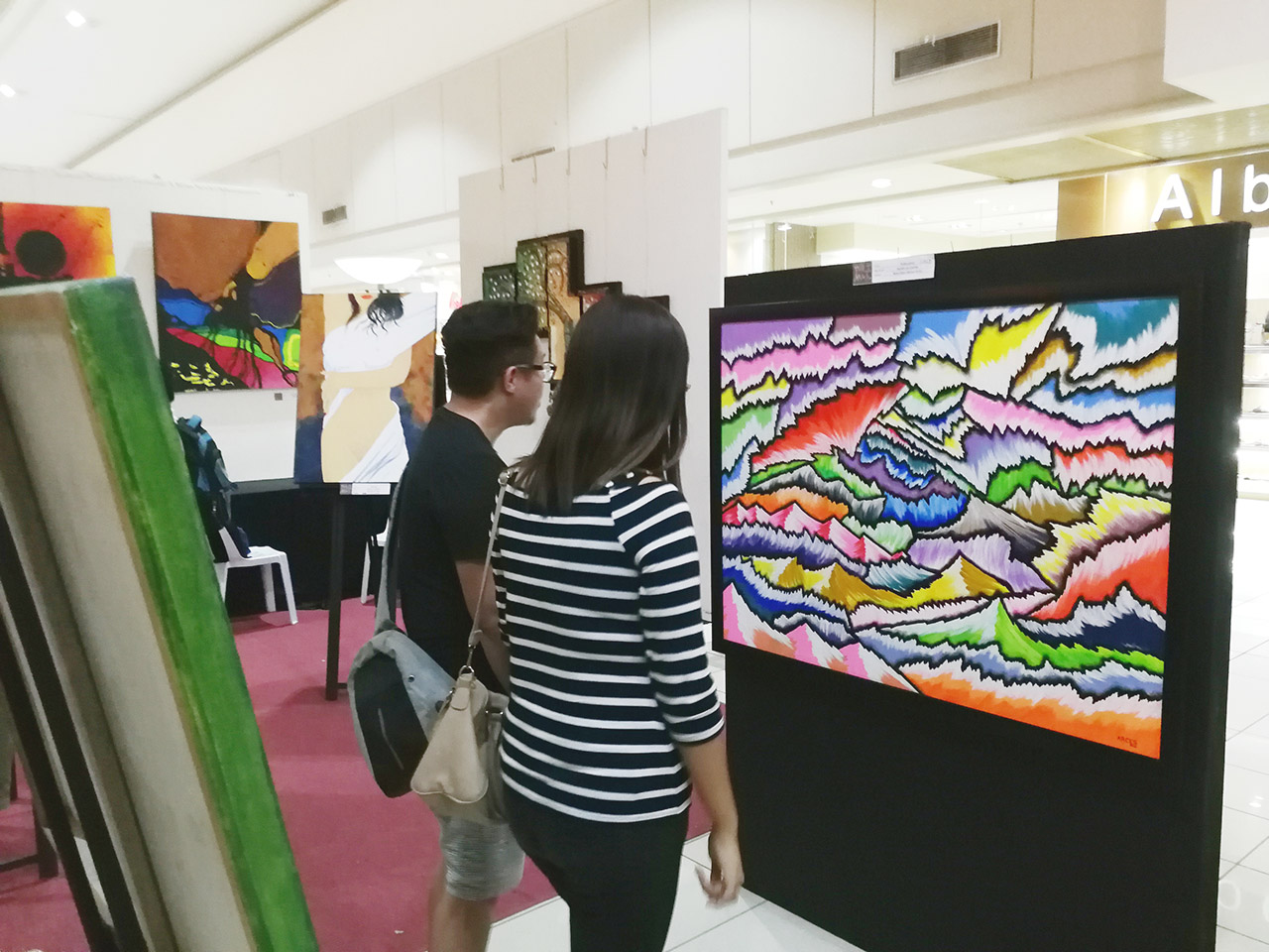 INCLUSIVE ART. Guests of the 'Primal' exhibit by Artsada Kagay-an Inc (AKI) view works of art by local artists. The exhibit aims to spread awareness about the realities faced by misrepresented and marginalized sectors in society. Photo by Angelo Lorenzo
