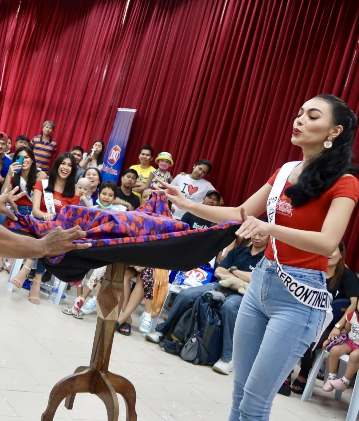 MAGIC. Emma Tiglao assists the magician during his show.