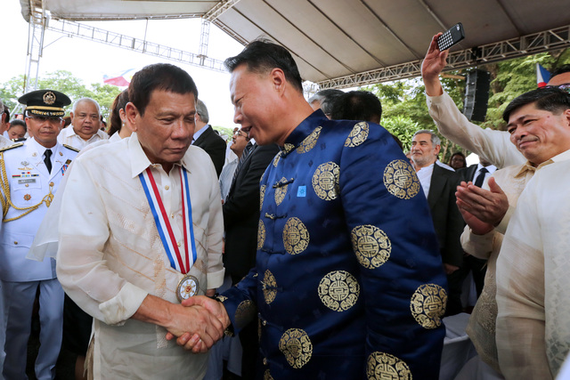 DUTERTE'S CHINA PIVOT. On National Heroes' Day, President Rodrigo Duterte shakes hands with Chinese Ambassador Zhao Jinhua. Photo from PPD