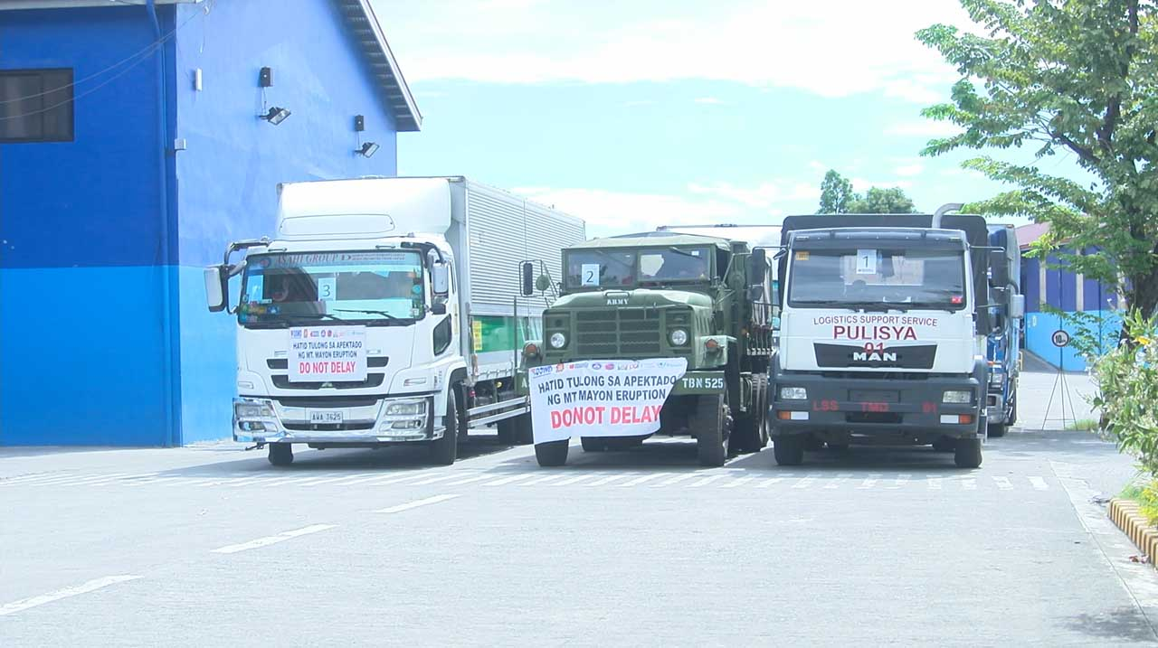 HELP. DSWD and other government agencies send-off more than 30 trucks of relief assistance for the families affected by Mayon eruption. Photo by Vee Salazar/Rappler