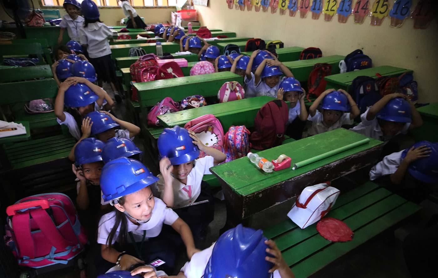 COVER. Corazon Elementary School pupils in Batasan, Quezon City. Photo by Darren Langit/Rappler