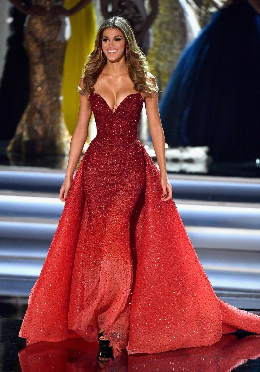 BLOOMING IN RED. Miss Universe 2016 Iris Mittenaere wears a red gown by Michael Cinco  during the 2017 Miss Universe Pageant at The Axis at Planet Hollywood Resort & Casino on November 26, 2017 in Las Vegas, Nevada. Photo by Frazer Harrison/Getty Images/AFP