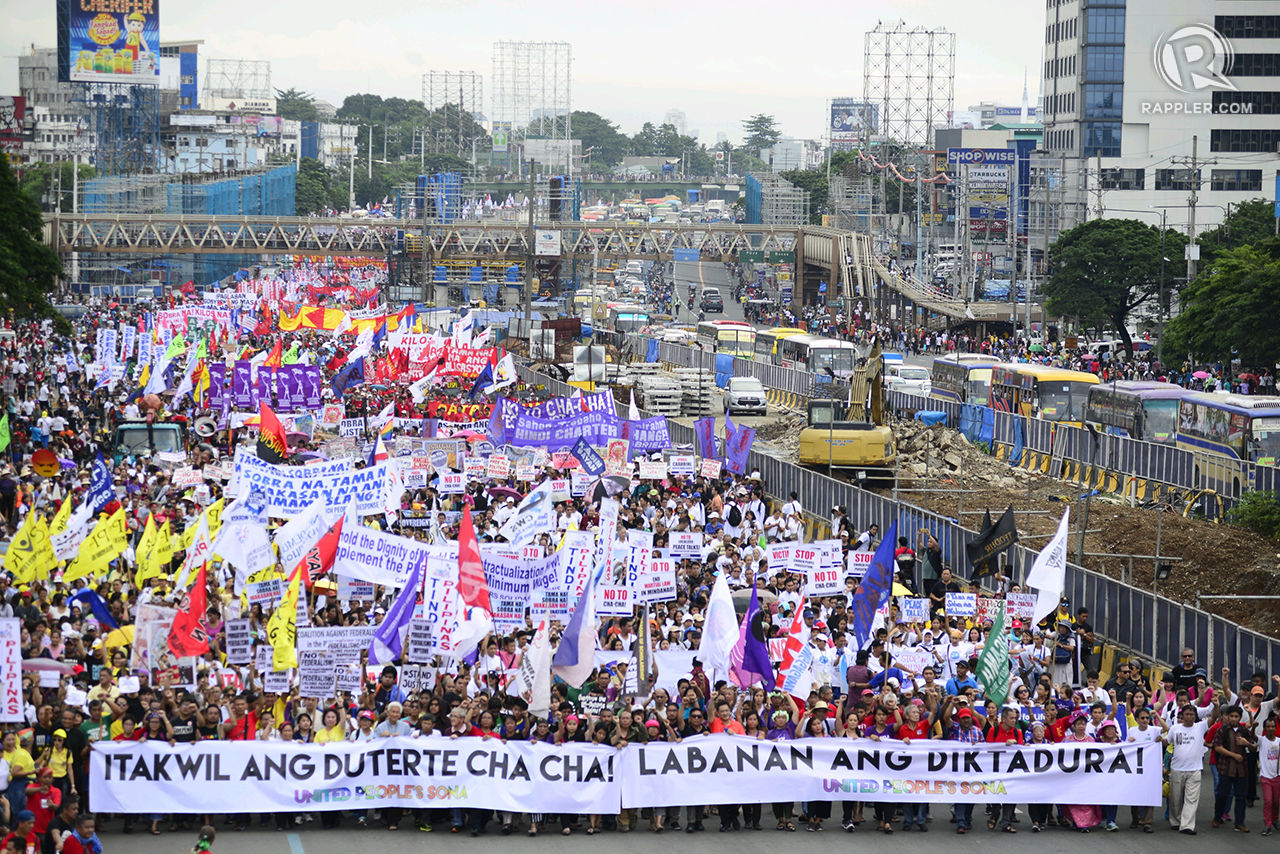 #SONA2018 PROTEST. As of 4:30 pm of Monday, July 23, 2018, thousands of anti-Duterte protesters gather along Commonwealth Avenue in Quezon City for the 'United People's SONA'. Photo by Maria Tan/Rappler