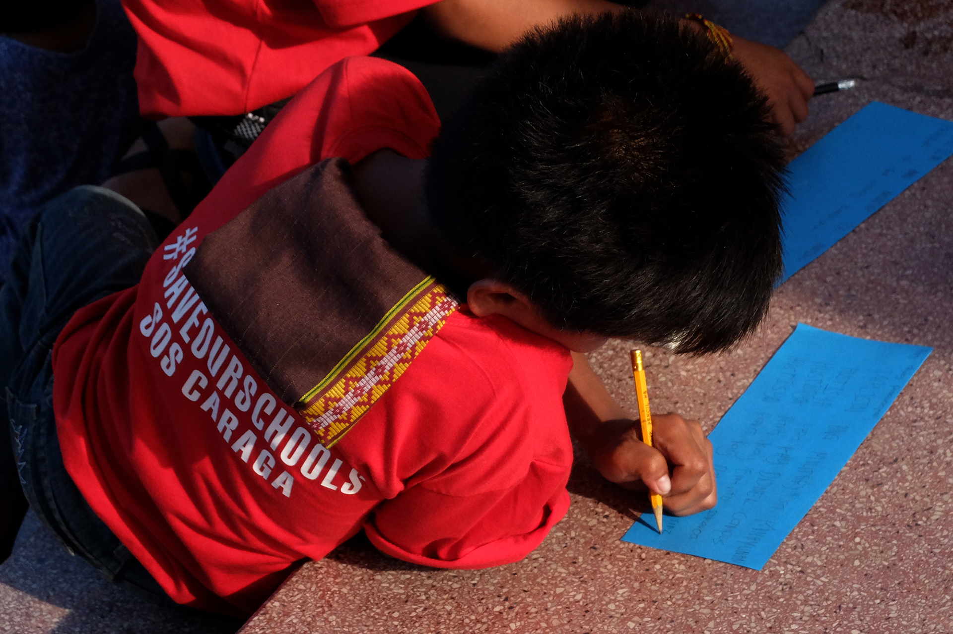 A CHILD'S WISH. A boy writes a letter to President Rodrigo Duterte. Photo by Angie de Silva/Rappler