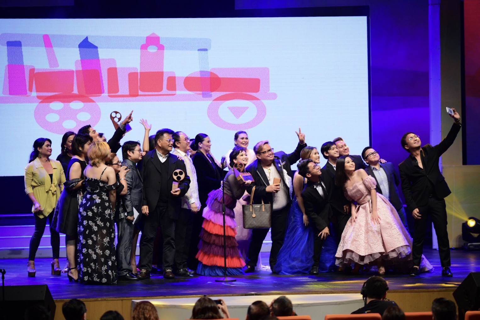 NEW RECORD. The Metro Manila Film Festival organizers announce they've reached P1.060 billion, the highest grossing MMFF festival ever. Photo shows the cast of 'Rainbow's Sunset' after their wins last December. File photo by Alecs Ongcal/Rappler