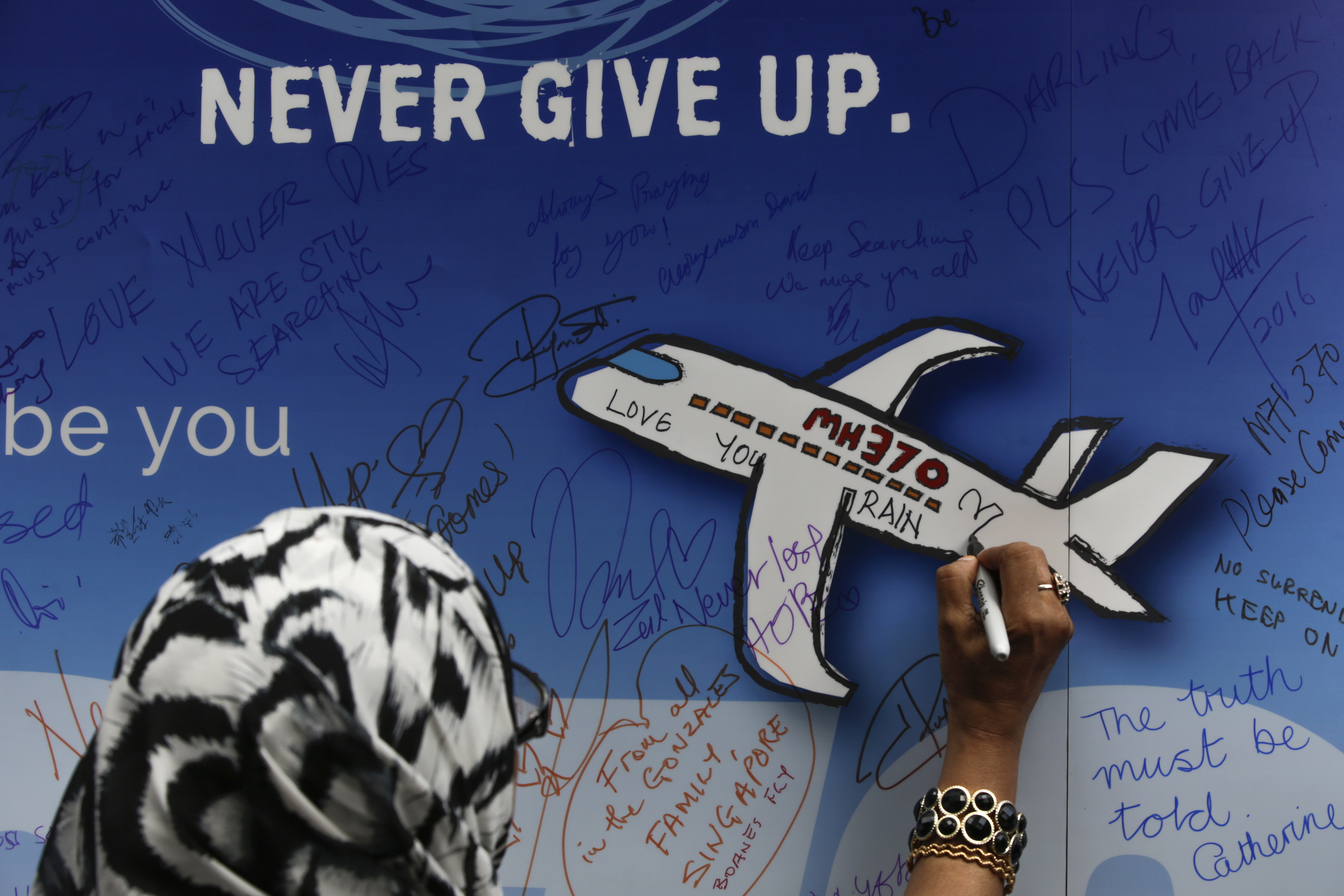 Two years on, MH370 kin want search extended