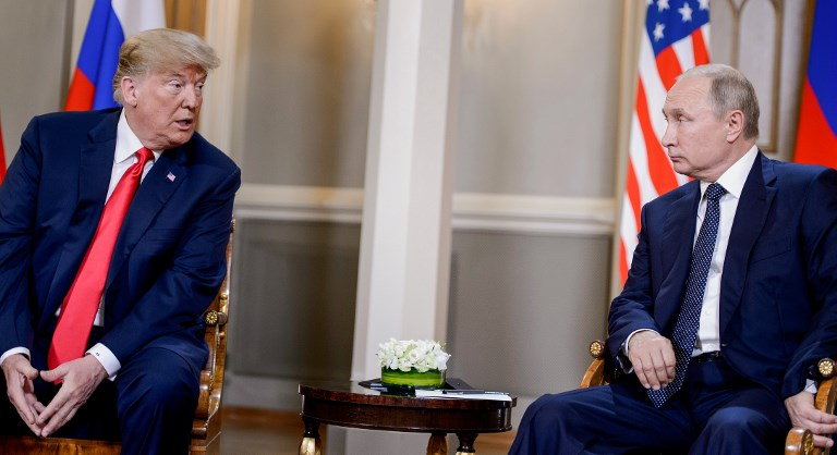 HELSINKI SUMMIT. Russia's President Vladimir Putin (R) listens while US President Donald Trump speaks before ahead of their meeting in Helsinki, on July 16, 2018. Photo by Brendan Smialowski/AFP