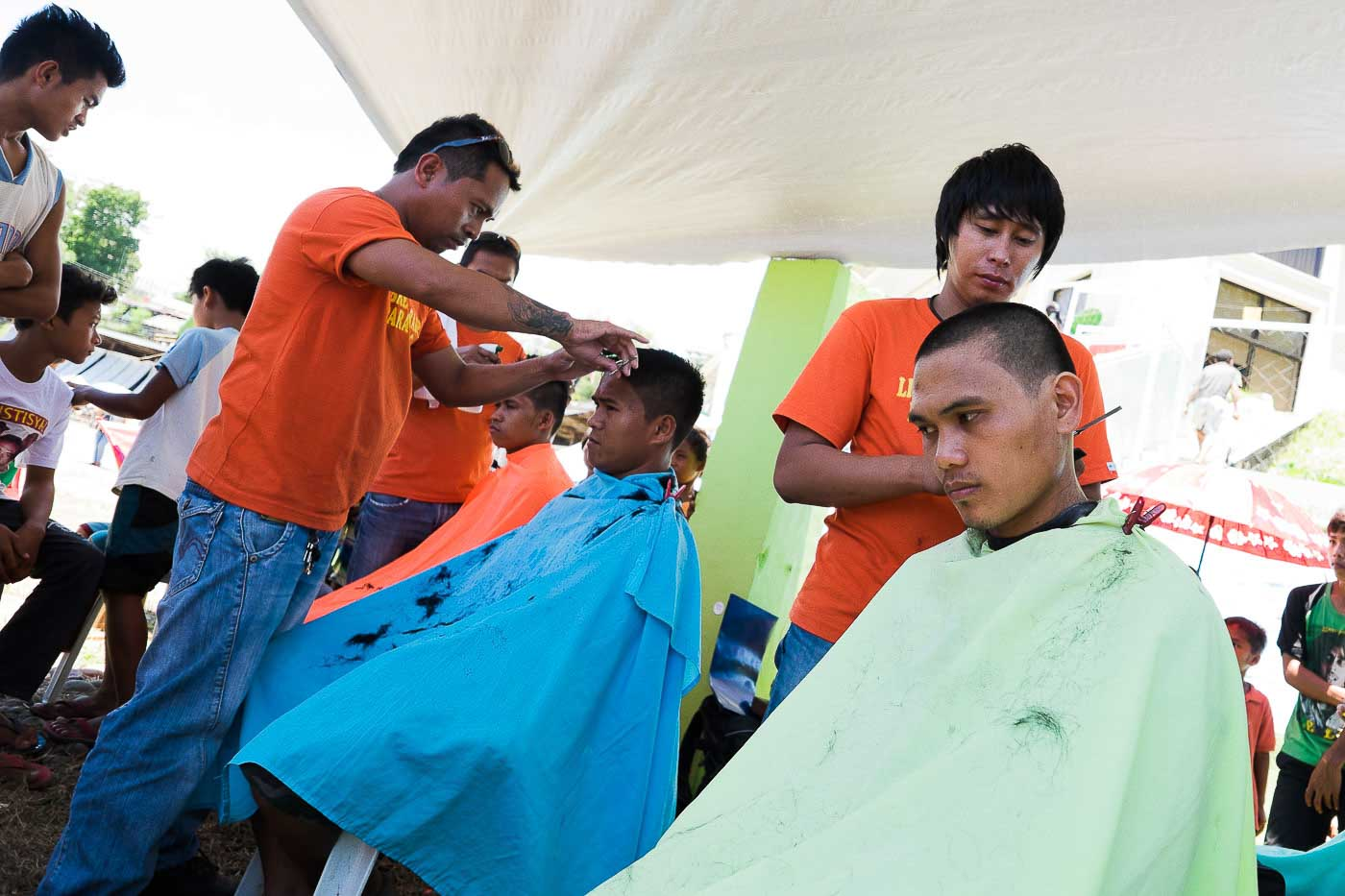 THE MEN. Getting haircuts at the Tandag City Sports Complex where almost 4,000 Lumads have been staying since September 1.
