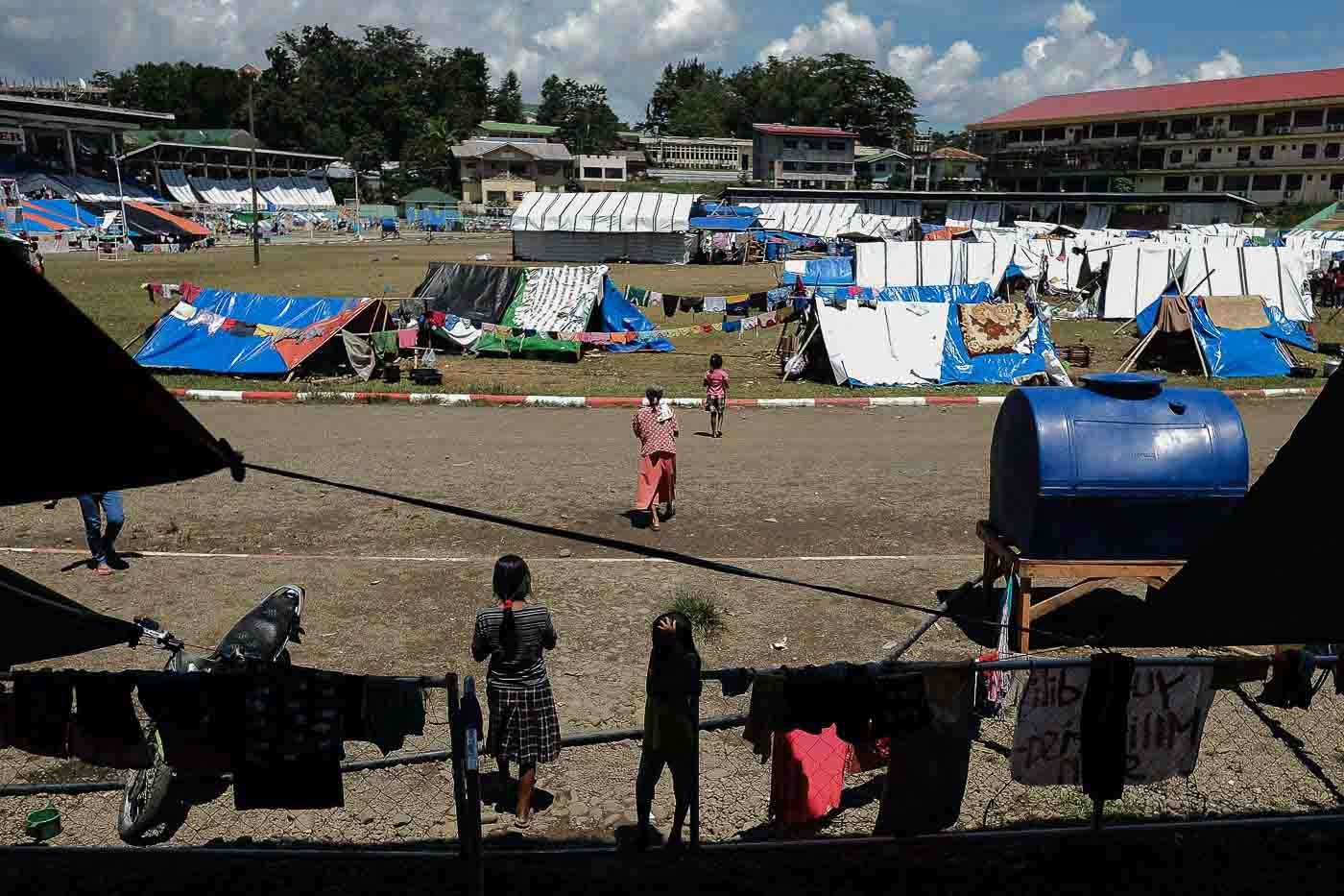 EVACUATION SITE. Lumads seek refuge in Tandag City Sports Complex in Surigao del Sur where they have been living on the bleachers and in makeshift tents since September 1.