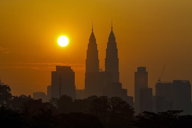 In this file photo, the Petronas Towers are pictured during sunrise in Kuala Lumpur, Malaysia, March 15, 2015. Azhar Rahim/EPA