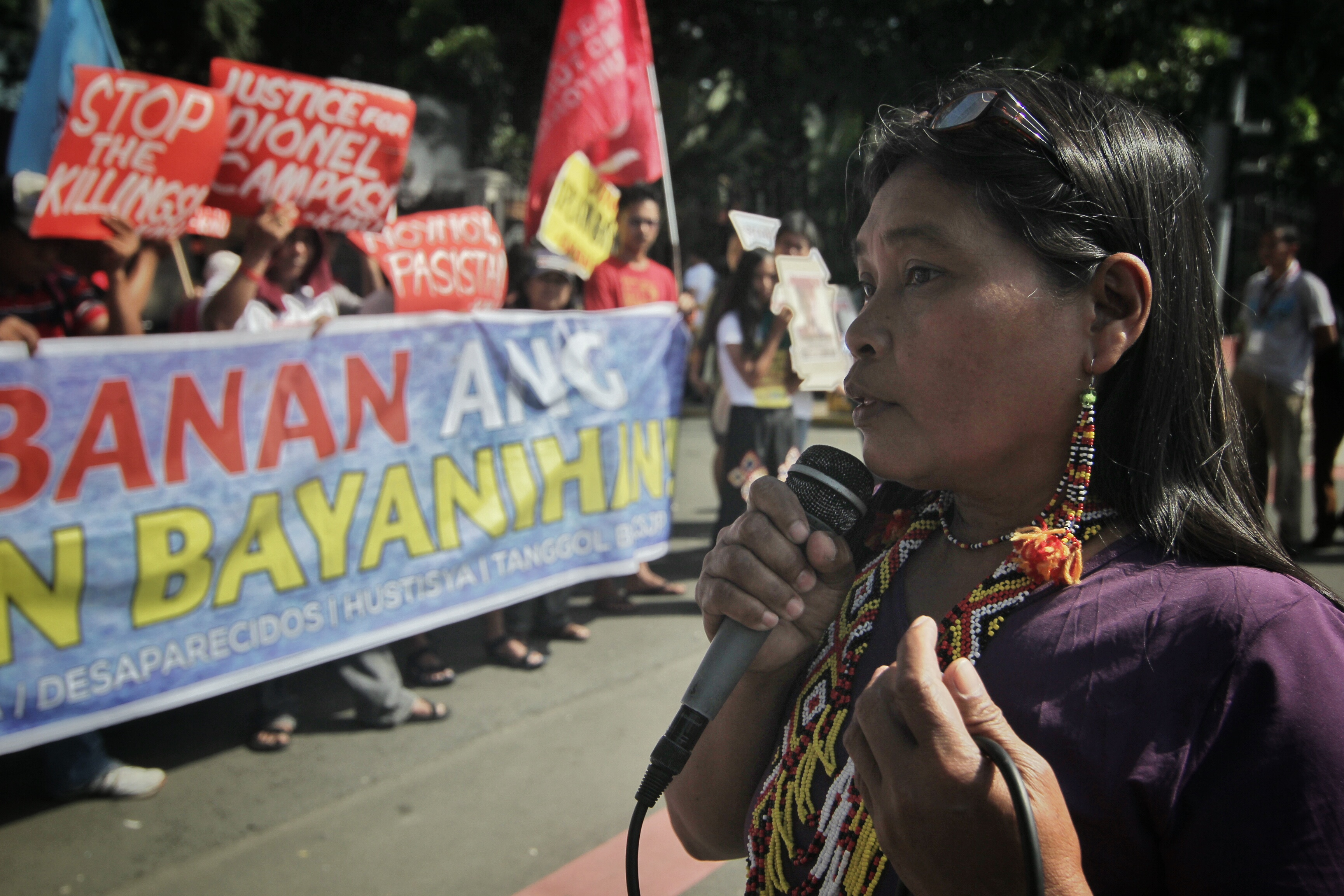 STOP LUMAD KILLINGS. Lumads, students, church, and rights group stage a protest outside the House of Representatives during the deliberation of military's budget for 2016. Sheina Campos, 12, Eufemia Cullamat, and other witnesses during the September 1 killings in Lianga, Surigao del Sur of tribal leaders join the protest action. Photo by Vincent Go/Rappler