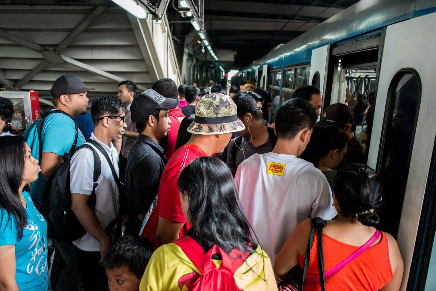 TIGHT. Commuters pack MRT trains.