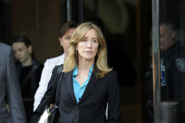 COURT APPEARANCE. Actress Felicity Huffman exits the courthouse after facing charges for allegedly conspiring to commit mail fraud and other charges in the college admissions scandal at the John Joseph Moakley United States Courthouse in Boston on April 3, 2019. Photo by Joseph Prezioso / AFP