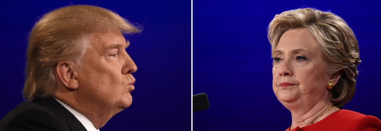 This file combination of pictures created on September 27, 2016 shows Democratic nominee Hillary Clinton (R) looking on during the first presidential debate at Hofstra University in Hempstead, New York on September 26, 2016, and Republican nominee Donald Trump (L) looking on during the first presidential debate at Hofstra University in Hempstead, New York.Timothy A. Clary and Jewel Samad