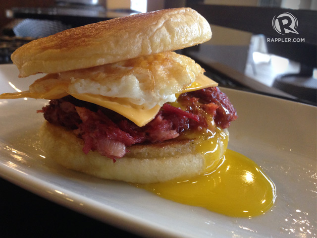 Corned beef, bacon, fried egg, and cheese, between English muffin ...