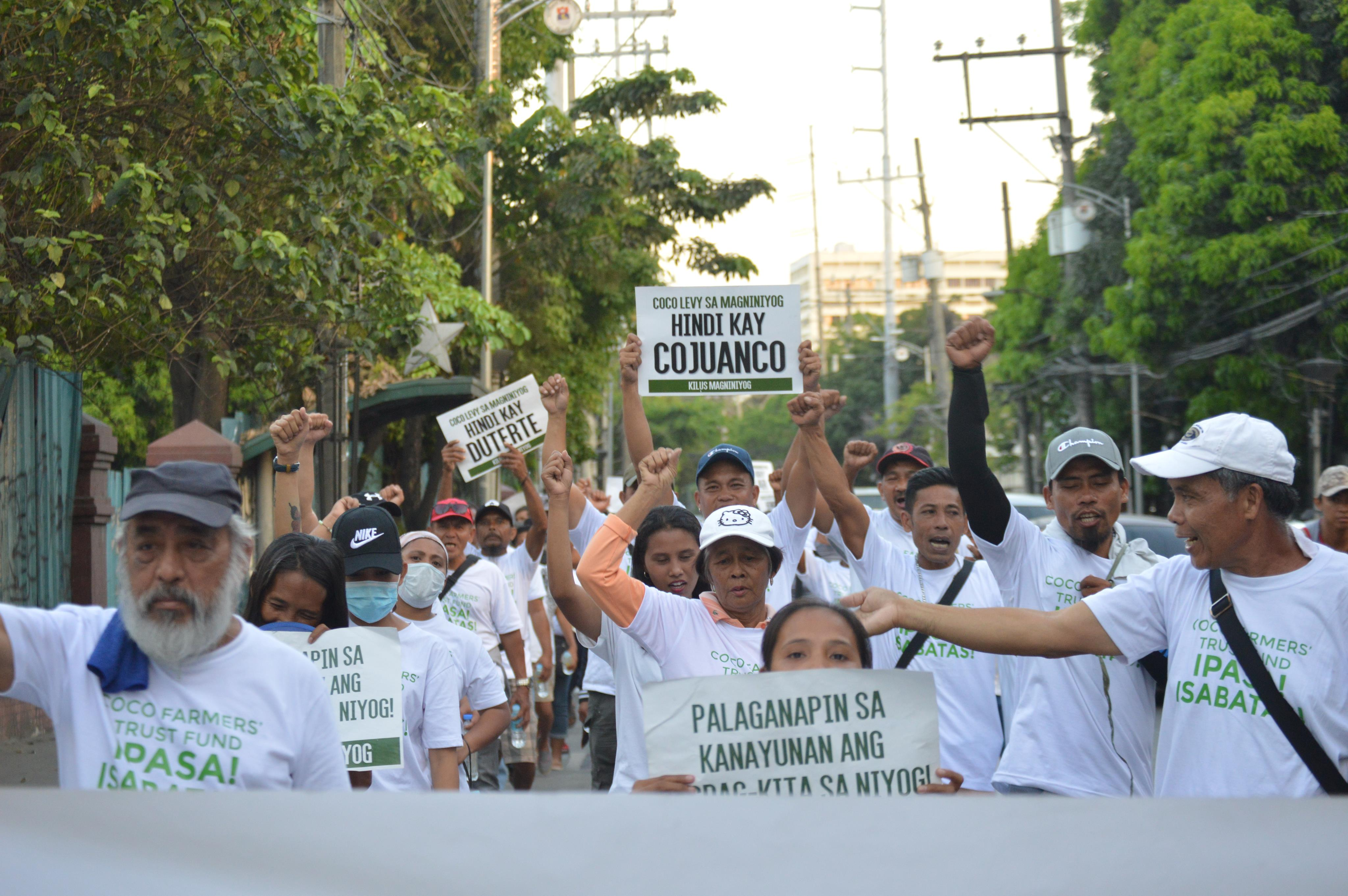 TRUST FUND. Coconut farmers marched from the Philippine Coconut Authority to Mendiola to protest the low prices of copra and to call for the passage of their version of the Coconut Farmers' Trust Fund. Photo courtesy of Kilus Magniniyog