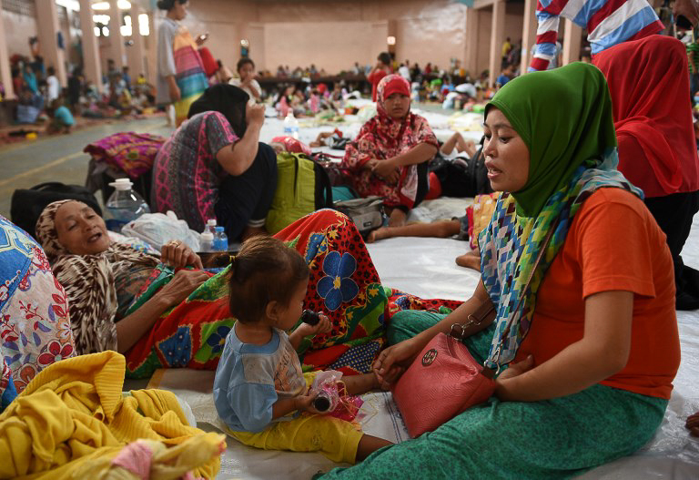 DISPLACED. A family from Marawi City rests at an evacuation center in Balo-i on May 29, 2017. Photo by Ted Aljibe/AFP