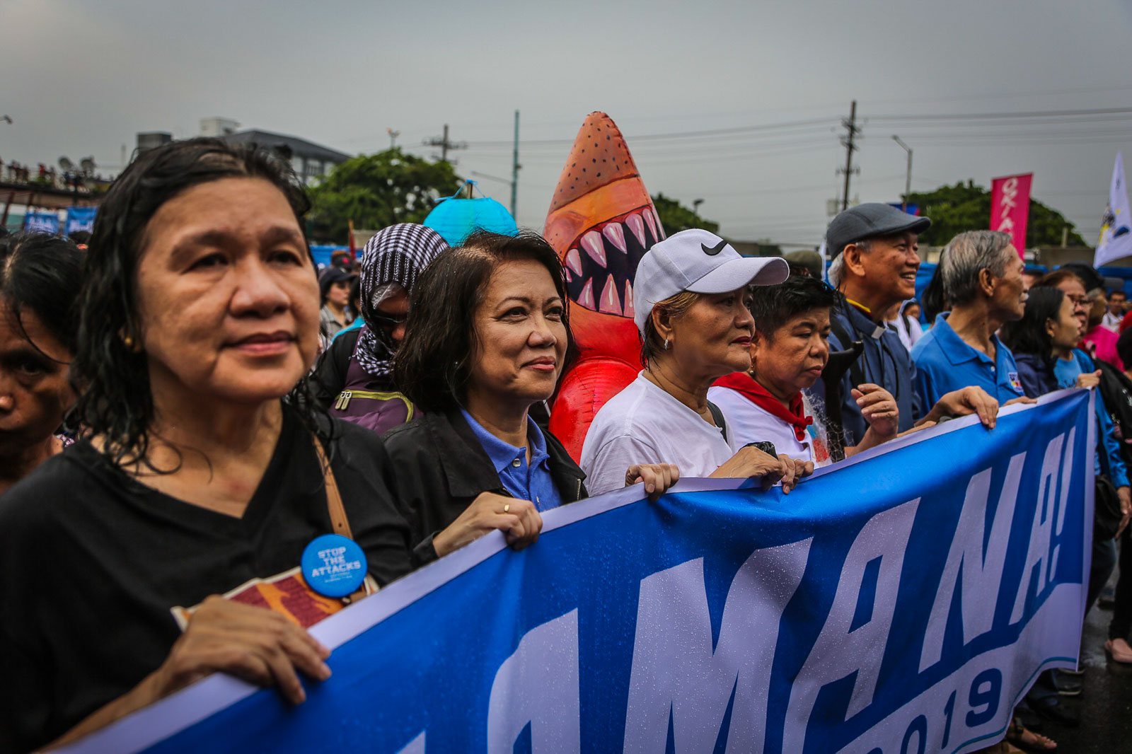 ENOUGH. Protesters from the United People's Sona brave the rain as they march along Commonwealth Avenue on July 22, 2019, to stage a program during President Rodrigo Duterte's State of the Nation Address. Photo by Jire Carreon/Rappler