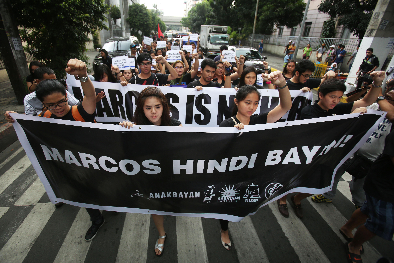CONTROVERSIAL BURIAL. UP Manila students protest the burial of the late dictator Ferdinand Marcos at the Libingan ng mga Bayani. Photo by Ben Nabong/Rappler