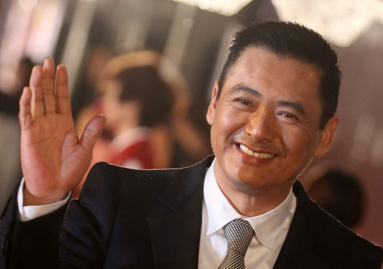 MODEST LIFESTYLE. Photo shows actor Chow Yun-fat posing on the red carpet of the Hong Kong Film Awards on April 17, 2011. The actor, who is one of the richest in Hong Kong has been known to live modestly, despite his wealth. File photo by Dale de la Rey / AFP