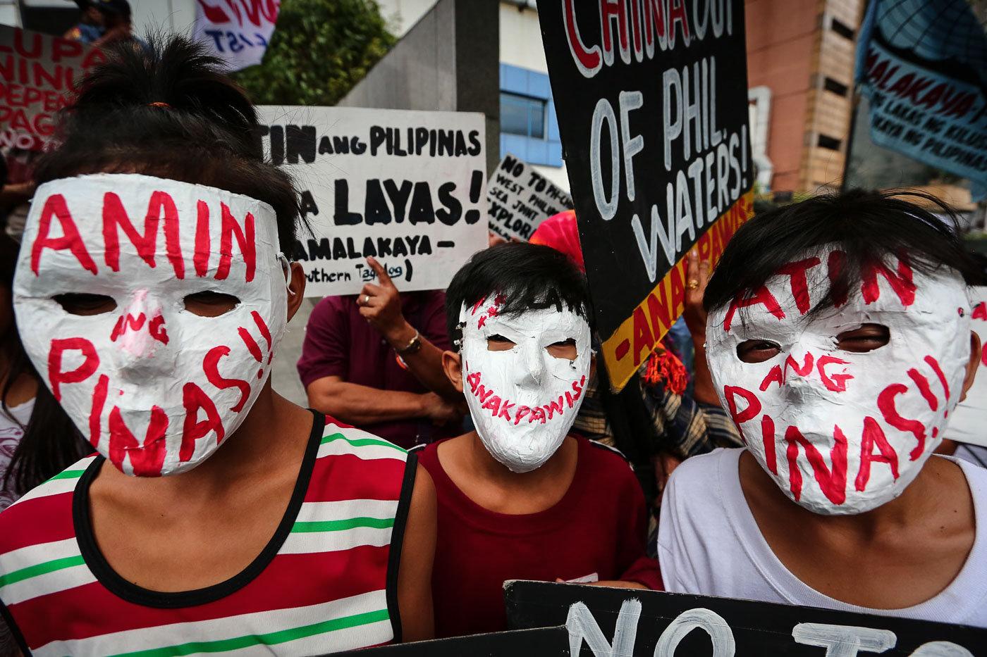 FOR THE PHILIPPINES. Men in masks make their own statement during a protest at the Chinese Consulate in light of Xi Jinping's PH state visit on November 20, 2018. Photo by Jire Carreon/Rappler