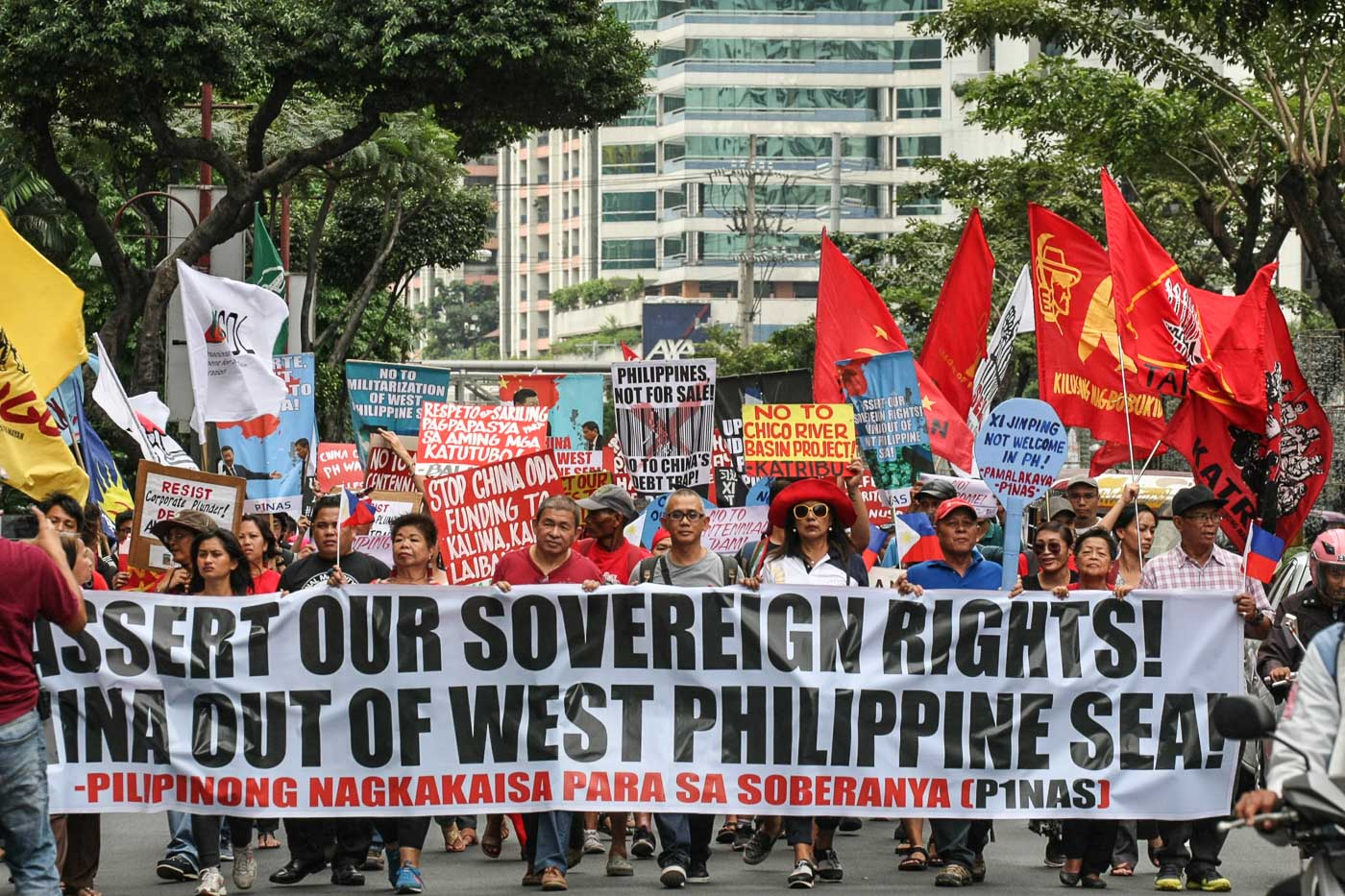 ASSERT RIGHTS. Groups stage a rally in front of the Chinese Consulate in Makati to protest the increasing militarization of the West Philippine Sea. Photo by Jire Carreon/Rappler