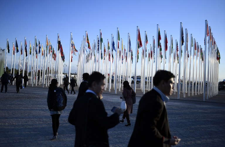 Delegates walk outside the COP22 Climate Change Conference in Marrakech on November 14, 2016. Photo by Stephane De Sakutin/ AFP