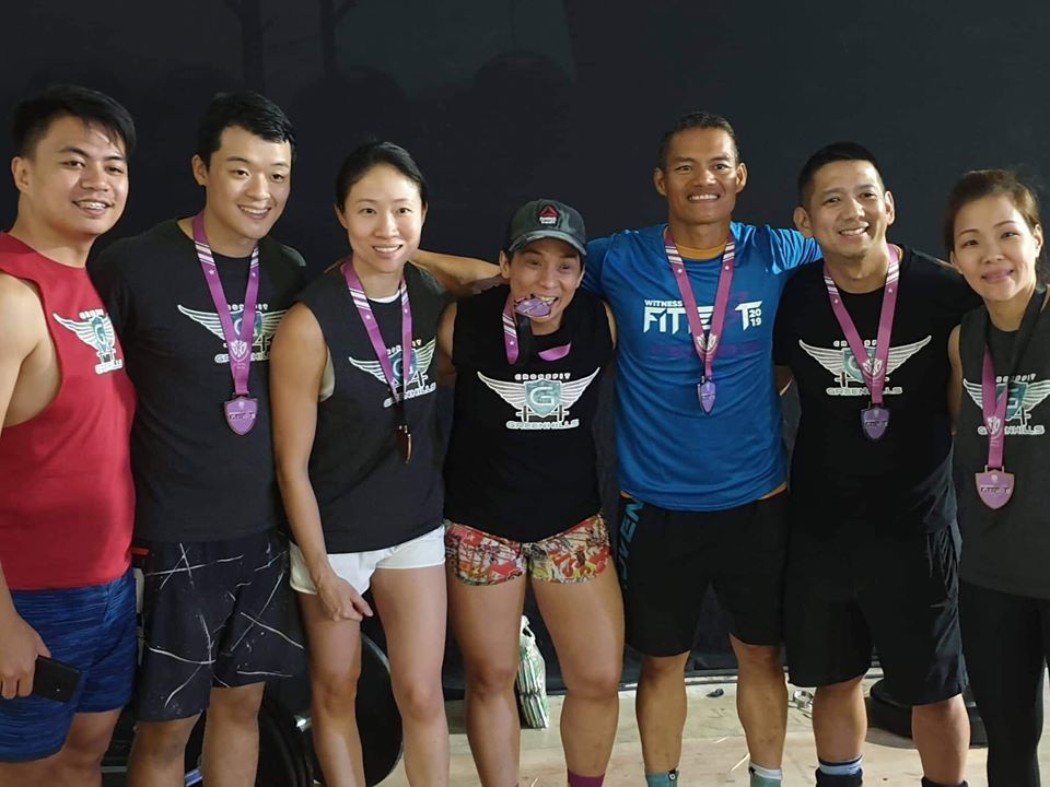 WINNER. CrossFit athletes Jen Yalung (fourth from left) celebrates a medal finish. Contributed photo