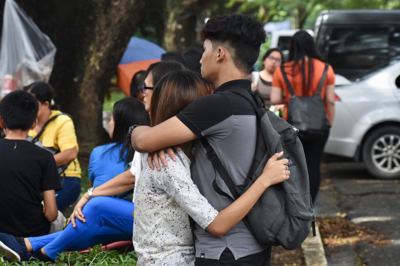 COMFORT. Tight hugs meet every UPCAT taker walking out of Palma Hall, followed by 'You did it!'