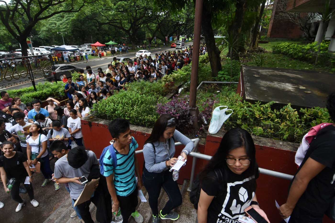 IT'S TIME. UPCAT takers fall in line for the final briefing and checking before they proceed to their designated testing rooms.