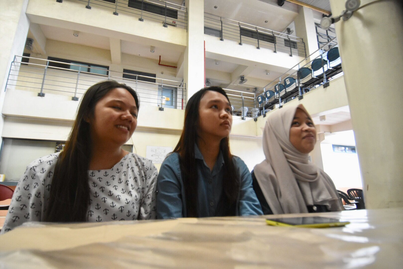 DETERMINED. Gumela, Caalaman, and Bahasuan (left to right) travelled all the way from Zamboanga City to take the UPCAT. All Photos by Angie de Silva/Rappler