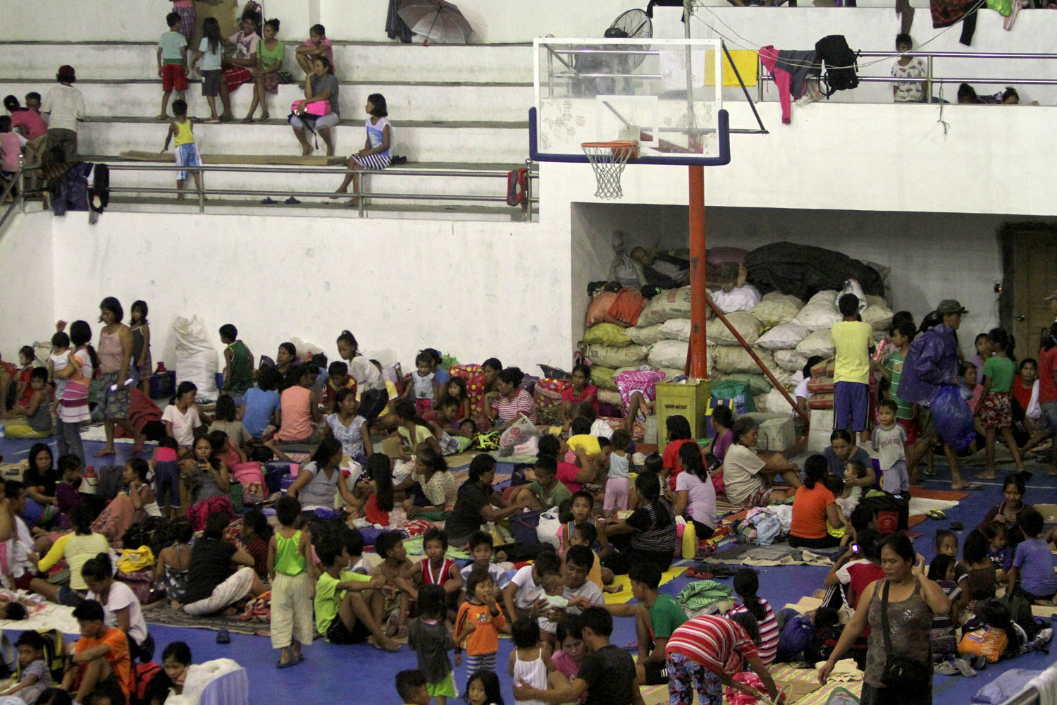 EVACUATED. More than 700 residents living along the shoreline take refuge in Alcala Gymnasium after preemptive evacuation due to Super Typhoon Lawin in Alcala town, Cagayan. Photo by Inoue Jaena/Rappler