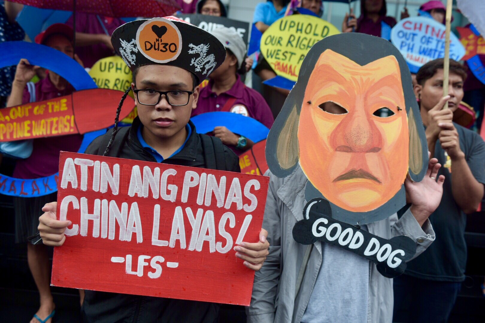 LAPDOG. Protesters portray President Duterte as China's lapdog for his tolerance of China's incursions in the disputed West Philippine Sea.