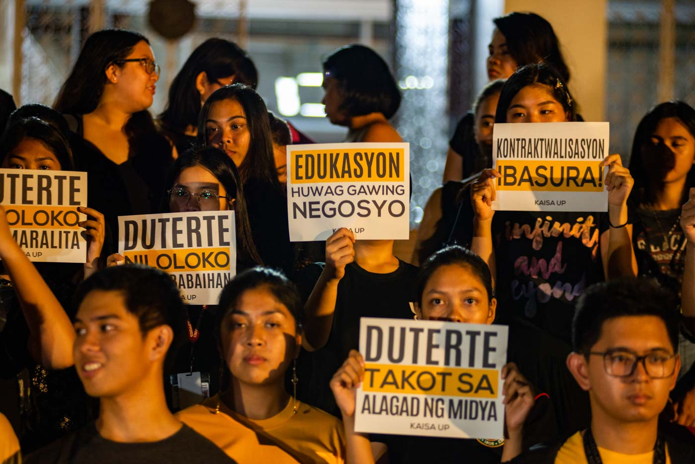 PROTEST. KAISA UP stages a torch rally against the recent arrest of Maria Ressa, and to call out the false promises of President Rodrigo Duterte to the people at the Palma Hall on April 2. All photos by Maria Tan/Rappler