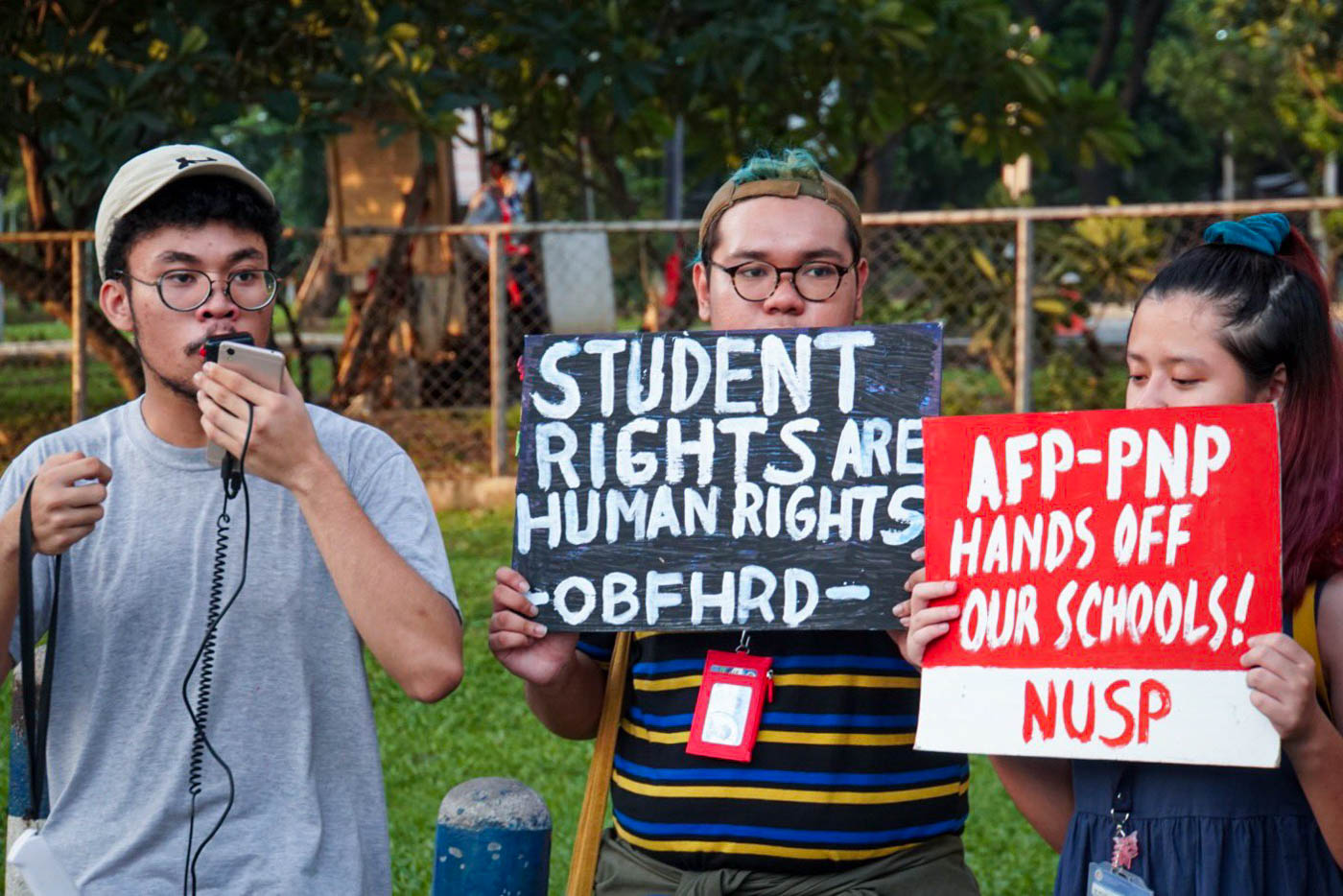 PROTEST. Various youth organizations stage a protest outside Gate 2.5 of ADMU to condemn human rights violations occurring nationwide. Photos by Casey Mateo/Rappler