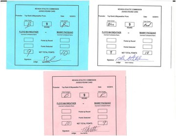 The cards of the three judges for round 9, showing two scoring it for Pacquiao and one for Mayweather