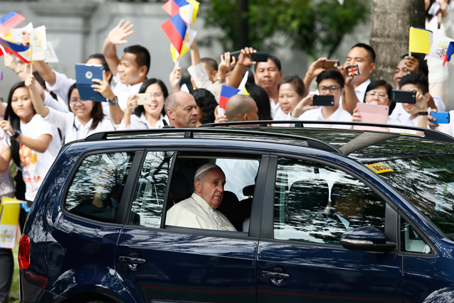 Pope Francis aboard a covered vehicle prior to his meeting with President Benigno Aquino III at the Malacanang Palace in Manila on January 16, 2015. Photot by Dennis Sabangan/EPA