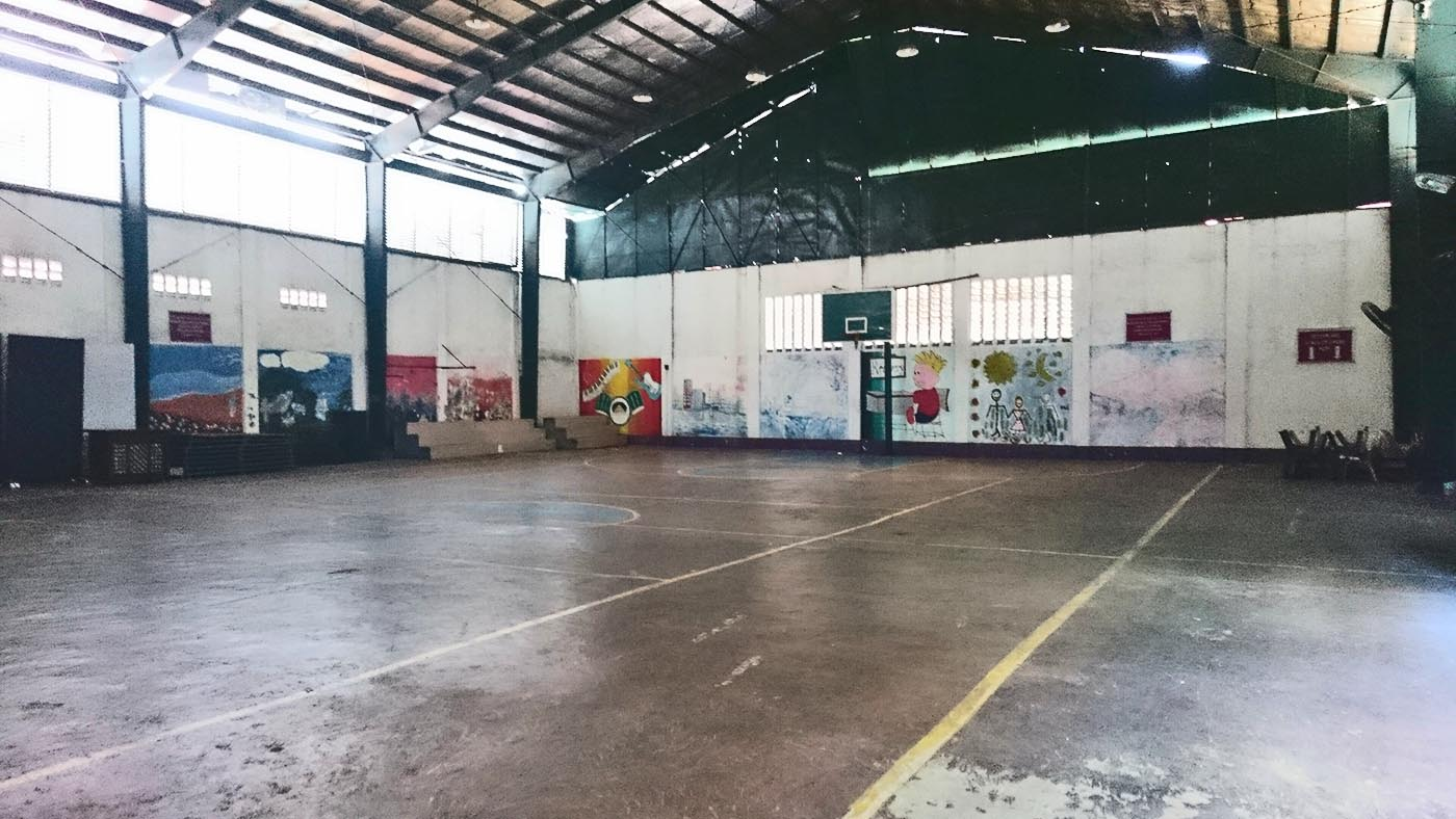 EMPTY INSIDE. The rehabilitation center's basketball court with murals painted by the trainees.