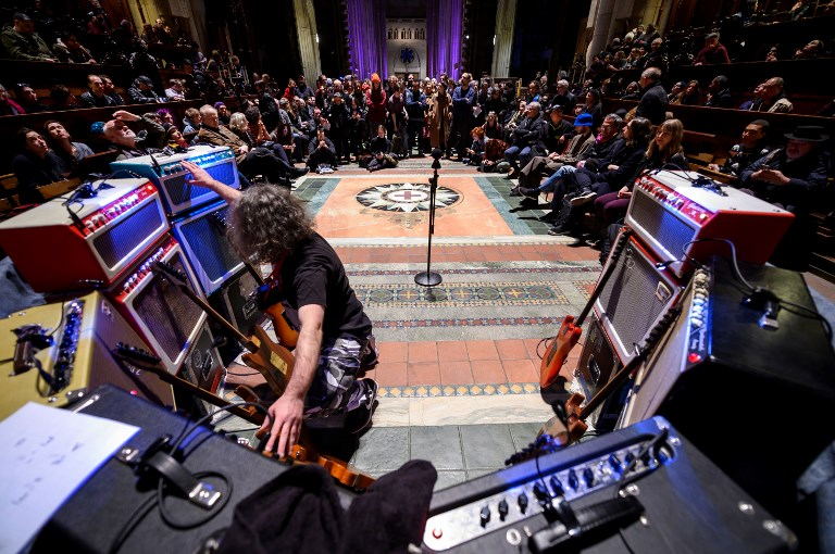 "LEGACY. Late US musician Lou Reed's former guitar technician Stewart Hurwood performs in the Cathedral Church of Saint Johan the Devine during the concert ""Lou Reed Drone"" on March 13, 2019 in New York City. Photo by Johannes Eisele/AFP"