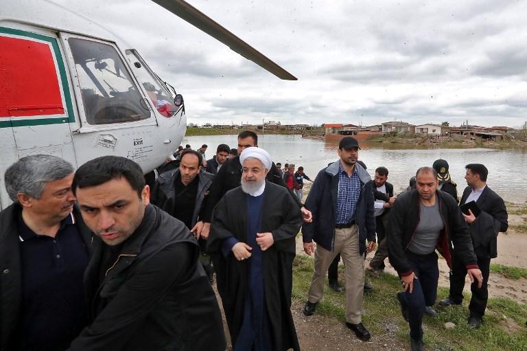 afp-20190327-iran-rouhani-floods.jpg